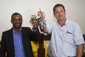 Japie Kotze, representing the contractors, hands over the functional set of keys to the new Denis Hurley Centre to Centre Manager Jean-Marie Ntamubano.